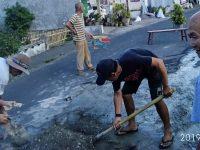 17 Tahun Jalan Bukit Kasih Dibangun dan Belum Kunjung Direhab, Ini yang Dilakukan Warga